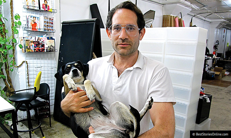 Dov Charney with frightened dog.