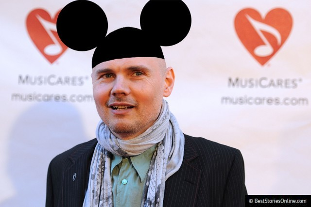 Corgan pictured wearing mouse ears at a charity event.