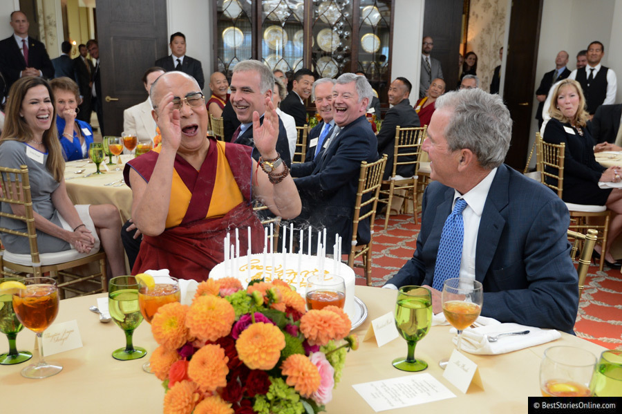 The Dalai Lama attending a charity dinner with former President George W. Bush.